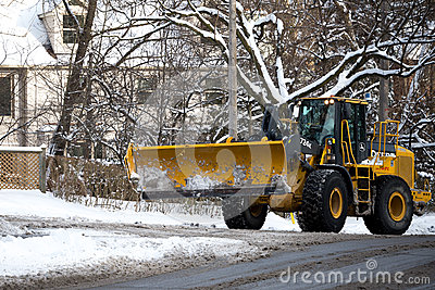 Snowplow sweeps the snow Editorial Photography