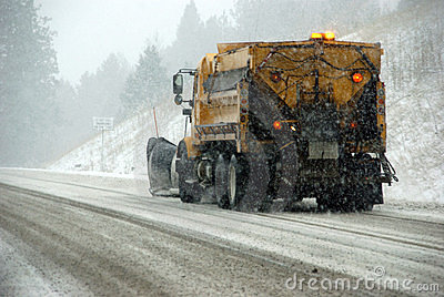 Snowplow truck on icy road
