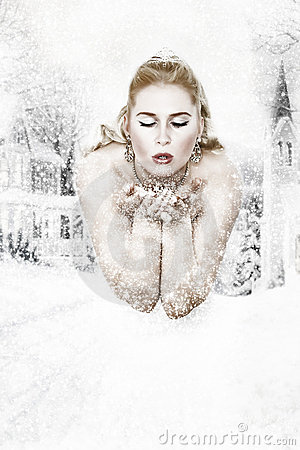 Snowqueen is blowing snowflakes