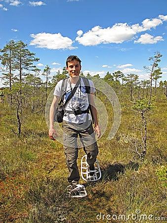 Snowshoe hiking man