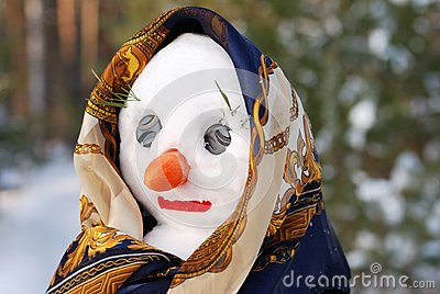 Snowwoman with hat, carrot nose and scarf