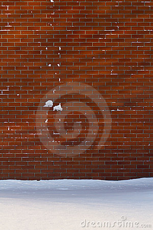 Snowy brick wall