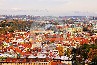 Snowy colorful autumn View on Prague City