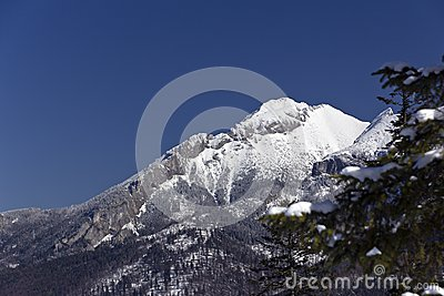 Snowy hilltops of tatra mountains in poland in win
