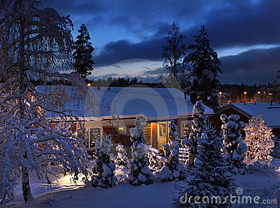 Snowy house on Christmas evening
