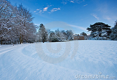 Snowy manor house grounds on a winter afternoon
