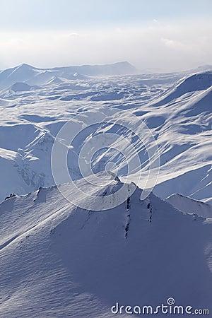 Snowy mountains in haze