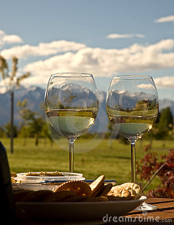 Free Snowy Mountains Seen Through Wine Glasses Stock Photo - 6740420