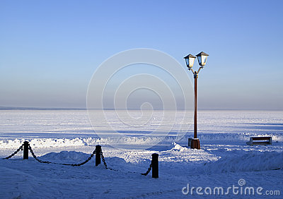 Snowy pier of Onego lake in Russia
