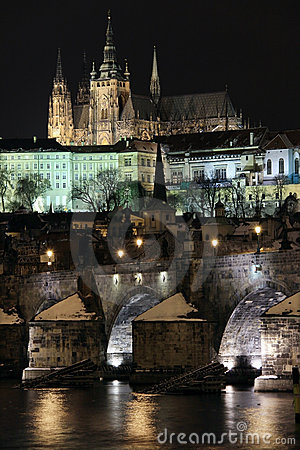 Snowy Prague gothic Castle on the River Vltava wit