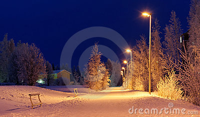 Snowy road at night