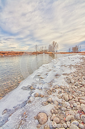 Free Snowy Rocky River Bank Royalty Free Stock Image - 64370276