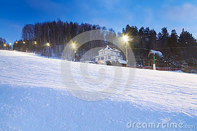 Snowy skiing resort at dusk