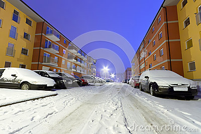 Snowy street with cars at winter