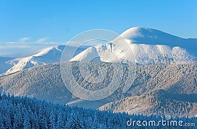 Snowy sunrise mountain landscape