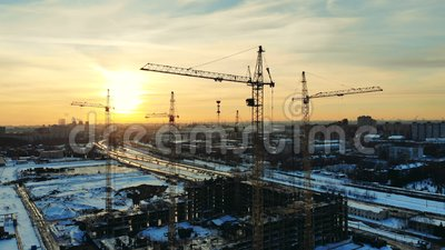 Snowy urban landscape with cranes in the building lot. 4K stock video footage