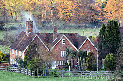 Snug English country house at dusk