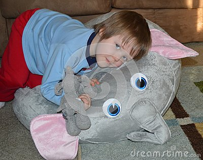 Toddler Snuggles his Elephant Nest