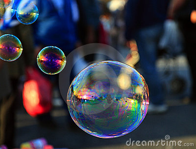 Soap bubble  on light ble background