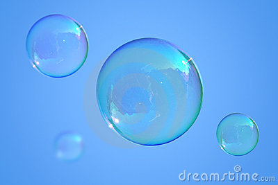 Soap bubbles on the blue sky