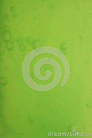 Soap bubbles green liquid background