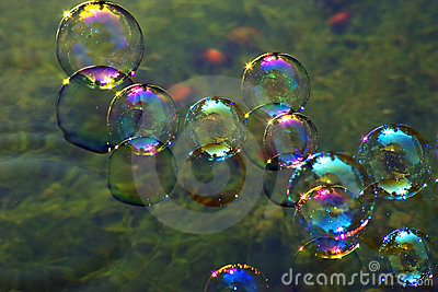 Soap bubbles on water