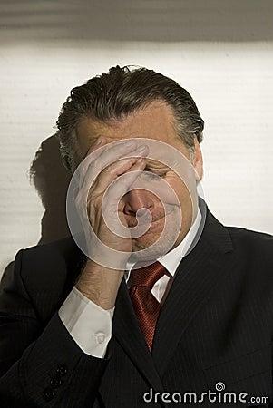 Sobbing businessman