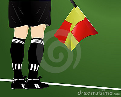 An soccer arbiter with flag