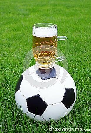 Soccer ball and beer mug