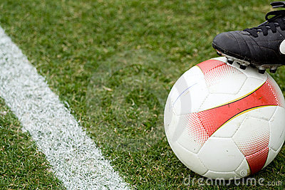 Soccer ball and a boot