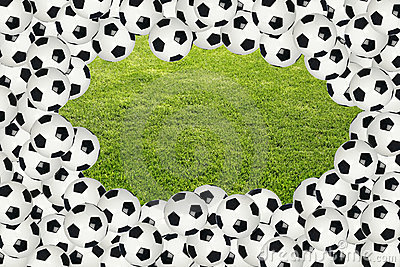 Soccer ball border over green grass