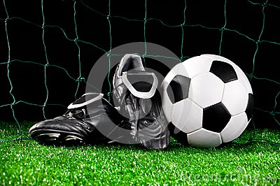 Soccer ball and cleats