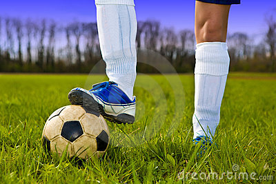 Soccer ball and feet of player