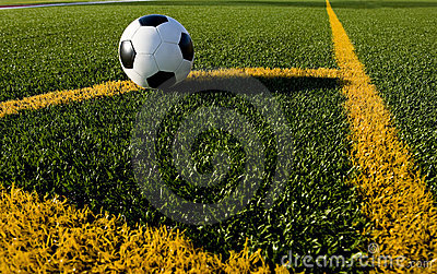 Soccer ball and football on a field