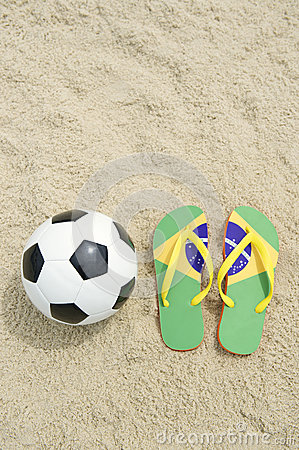 Soccer Ball Football and Flip-Flops on Brazilian Beach
