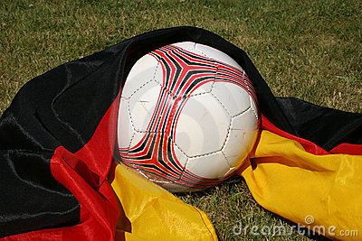 Soccer ball in front of a german flag