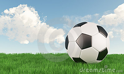 Soccer ball on green grass field with blue sky