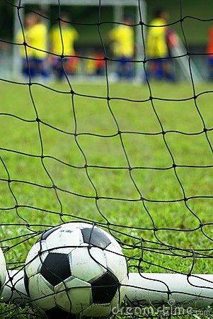 Free Soccer Ball In Net At Field Stock Images - 1469654