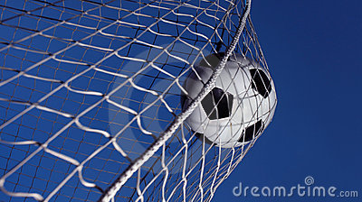 soccer ball kicked into a goal stock photography image