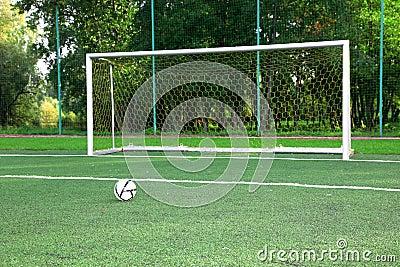 Soccer ball on stadium field