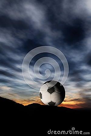 Soccer ball in sunset