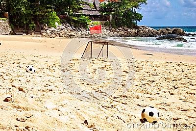 Soccer balls on sand