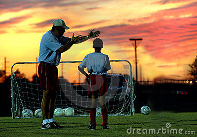 Soccer coaching at sunset