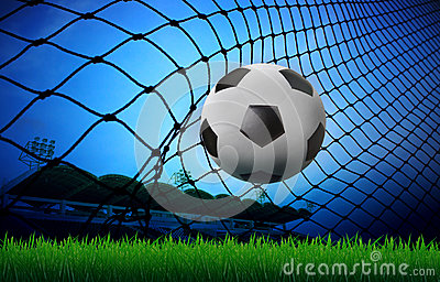 Soccer football in goal net and stadium blue sky b