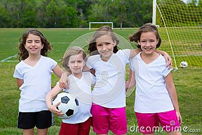 Soccer football kid girls team at sports fileld