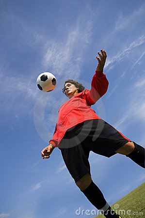 Free Soccer Football Player In Red Controlling Ball Stock Photos - 918263