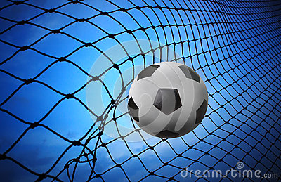 soccer football shoot into goal net