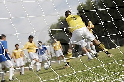 Soccer game seen through net