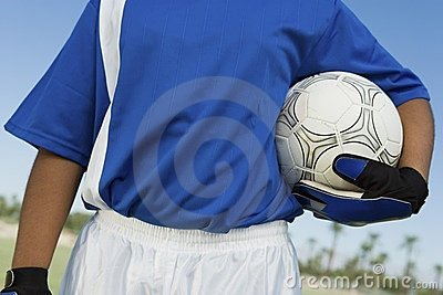 Soccer goalkeeper (13-17) holding ball