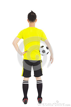 Soccer player holding a soccer next to  waist
